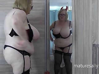 Naughty granny devil admires herself in the mirror