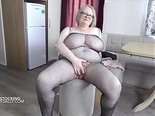 Mature Sally teases in one of her bodystockings