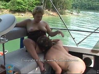 Busty mature lesbians on a boat