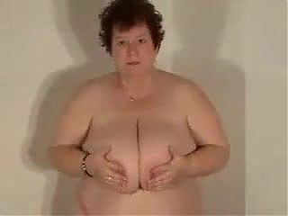 Granny playing with her huge tits
