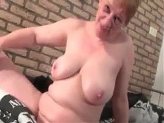 Busty Granny unable to resist playing