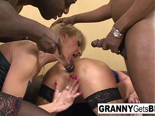 Two mature blondes have an interracial anal foursome